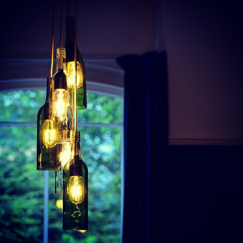 - Inside we got creative and, inspired by our friends at POP in Porthmadog, made a new light fitting for our snug out of old wine bottles. After a few trial runs involving YouTube video tutorials, string and nail polish remover, we were pretty pleased with the result!