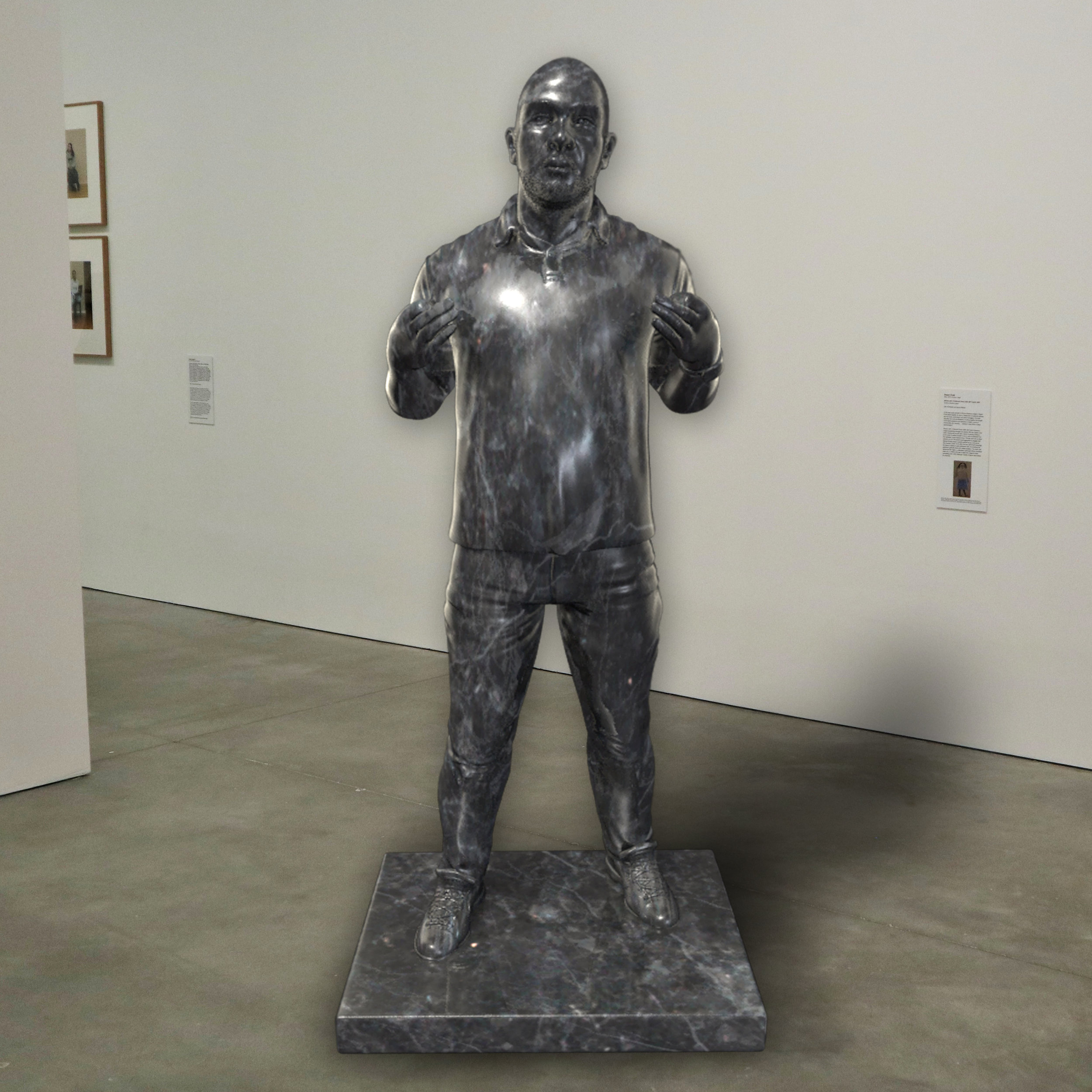 """""""Roxbury,"""" onyx, Institute of Contemporary Art, Boston   2018  JPG  During an installation at the Institute of Contemporary Art in Boston, viewers were invited to imagine themselves as statues in the ICA's permanent collection. Participants were photographed posing as a statue they felt represented themselves, created a name for their fictional statue, and selected a stone from which their statue would be made. Professional and amateur digital artists were commissioned to create renderings of the statues, which were superimposed on photos of the ICA's permanent collection gallery space."""