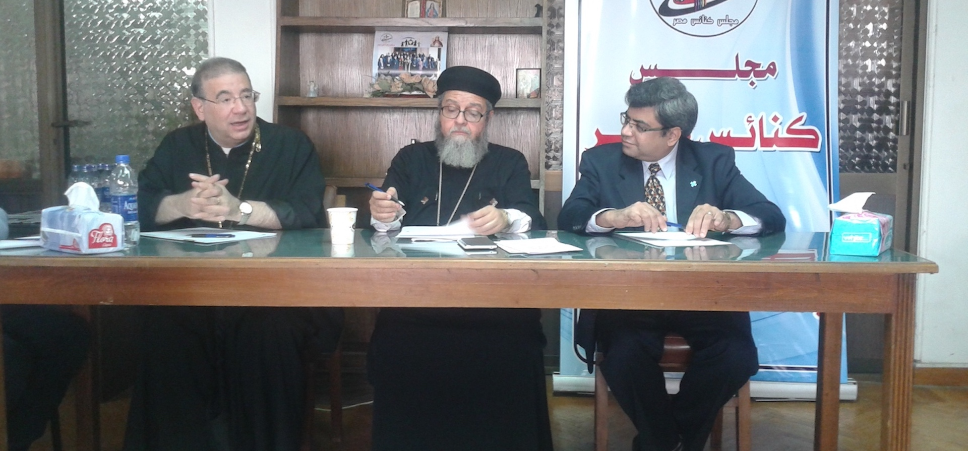 Photo:Father Rafic Greiche, a Catholic priest; Father Bishoy Helmy, an Orthodox priest; and Reverend Rifaat Fikry, a Protestant pastor speak at a meeting of Egypt Council of Churches.