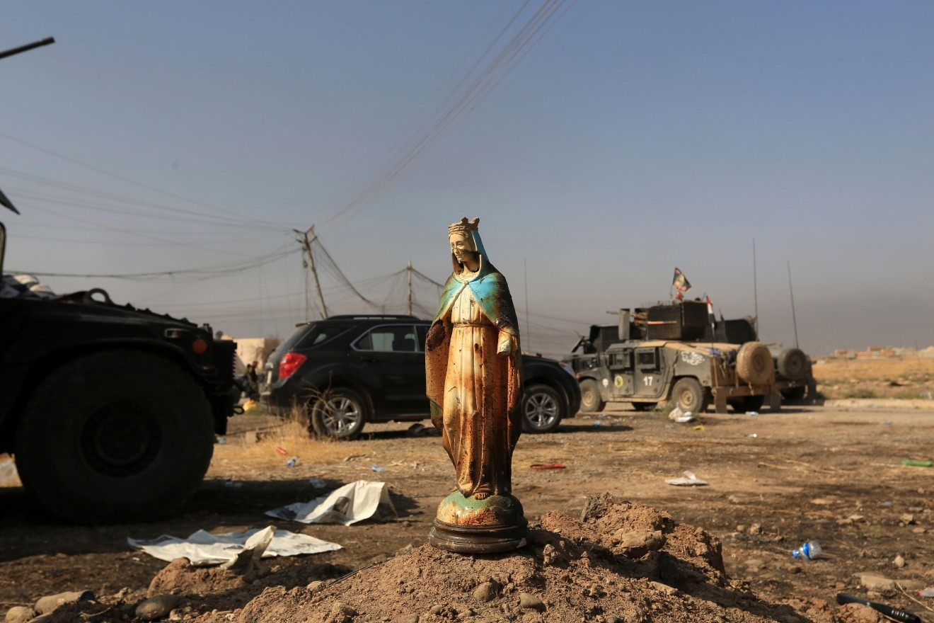 A statue of Virgin Mary is placed in a street in Bartella, Iraq, Sunday, October 23, 2016. Iraqi forces captured Bartella, around nine miles east of Mosul. Photo by AP Photo/Khalid Mohammed.