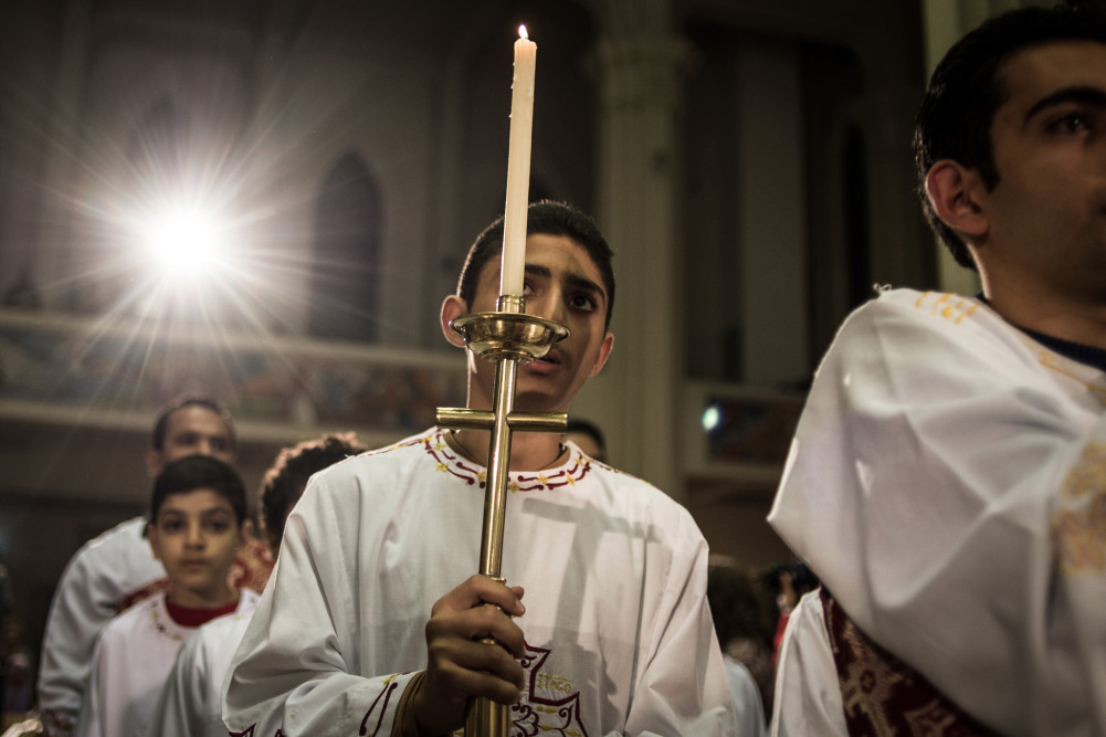 Egyptian Coptic Catholic altar boys attend Christmas Eve mass at a church in Cairo, Egypt, on Dec. 24, 2014.  Some rights reserved  by  Chaoyue Pan