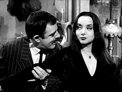GOMEZ AND MORTICIA TOGETHER  SLY LOOK.jpg
