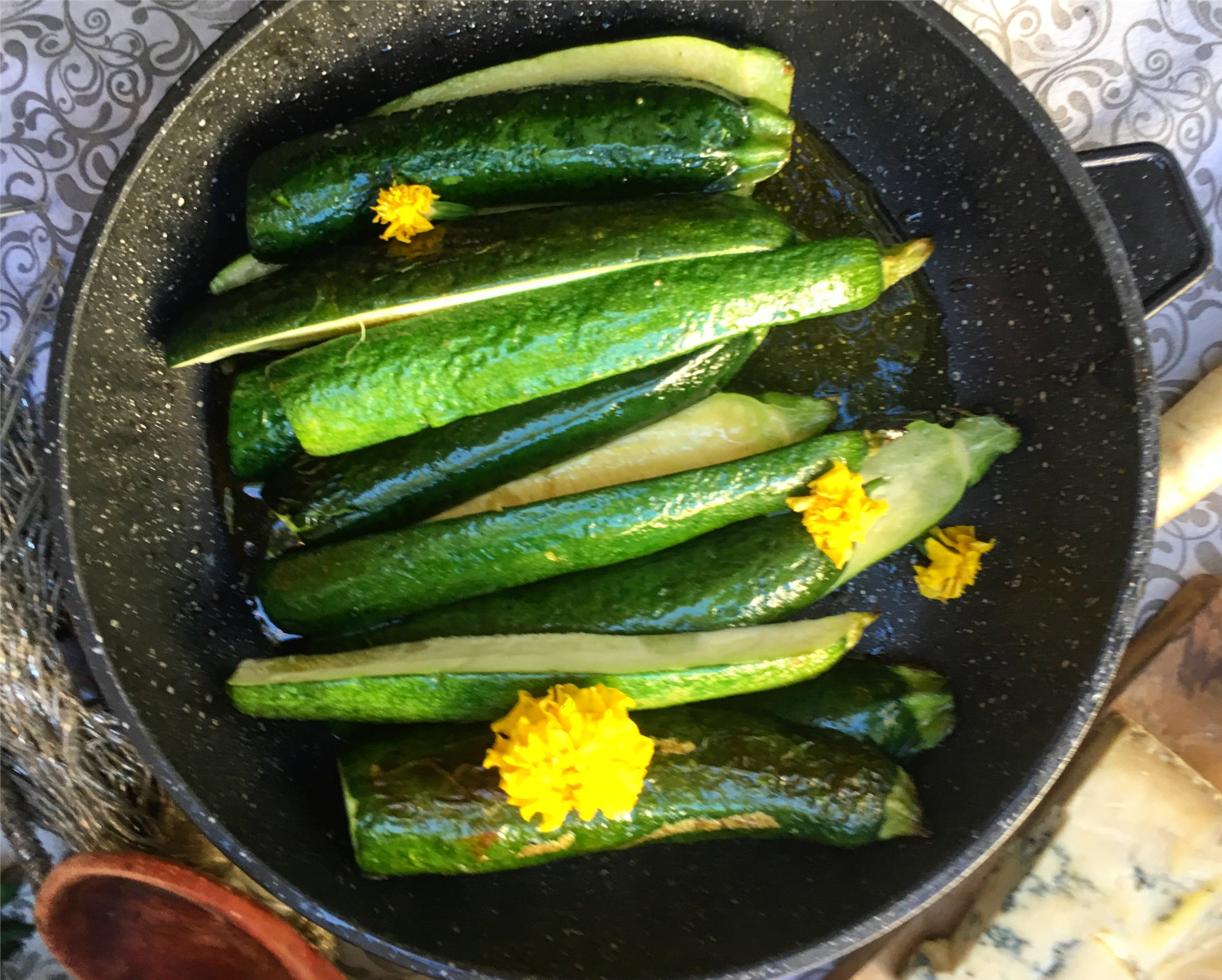 Zucchini with edible marigolds. The marigold color evokes zucchini blossoms (which can be hard to find). After adding salt and pepper, you can finish these in your oven in the same EuroCAST Dutch oven after you've removed the chicken and lentils (as above), or one of our sauté pans on the stovetop.Cook to desired doneness. I suggest about 5-7 minutes.