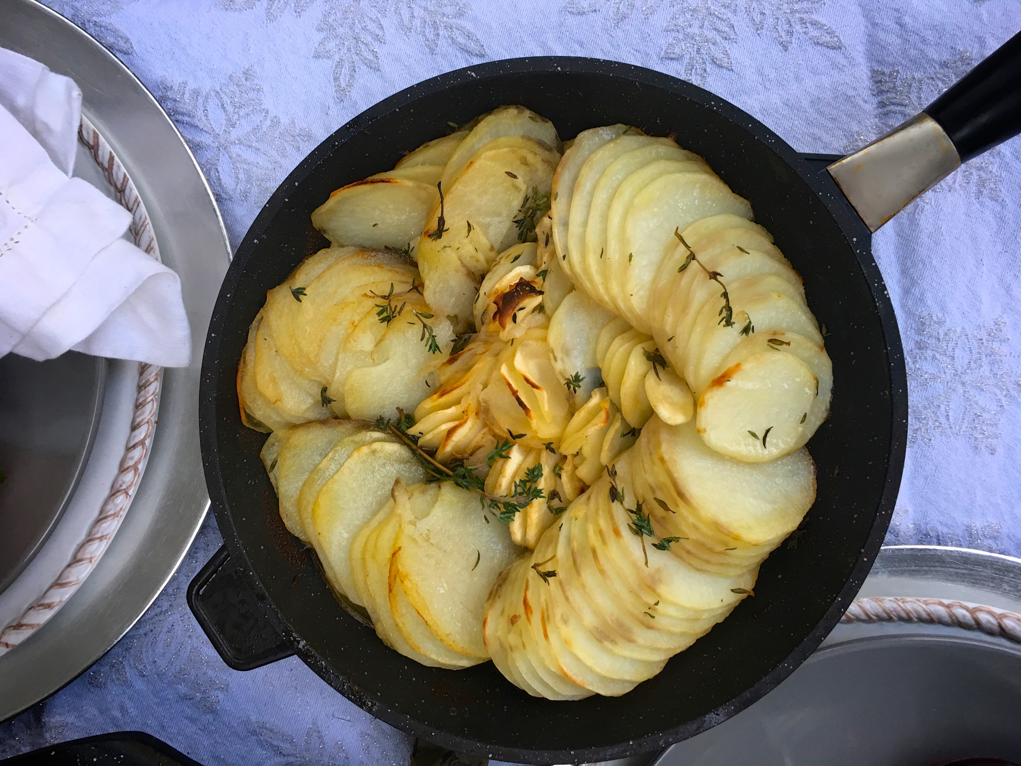 Our holiday caravan is about rich herbs, lovely spices, perfect fruits, full-flavored mushrooms. And we get started with a bit of thyme in a lovely potato dish.
