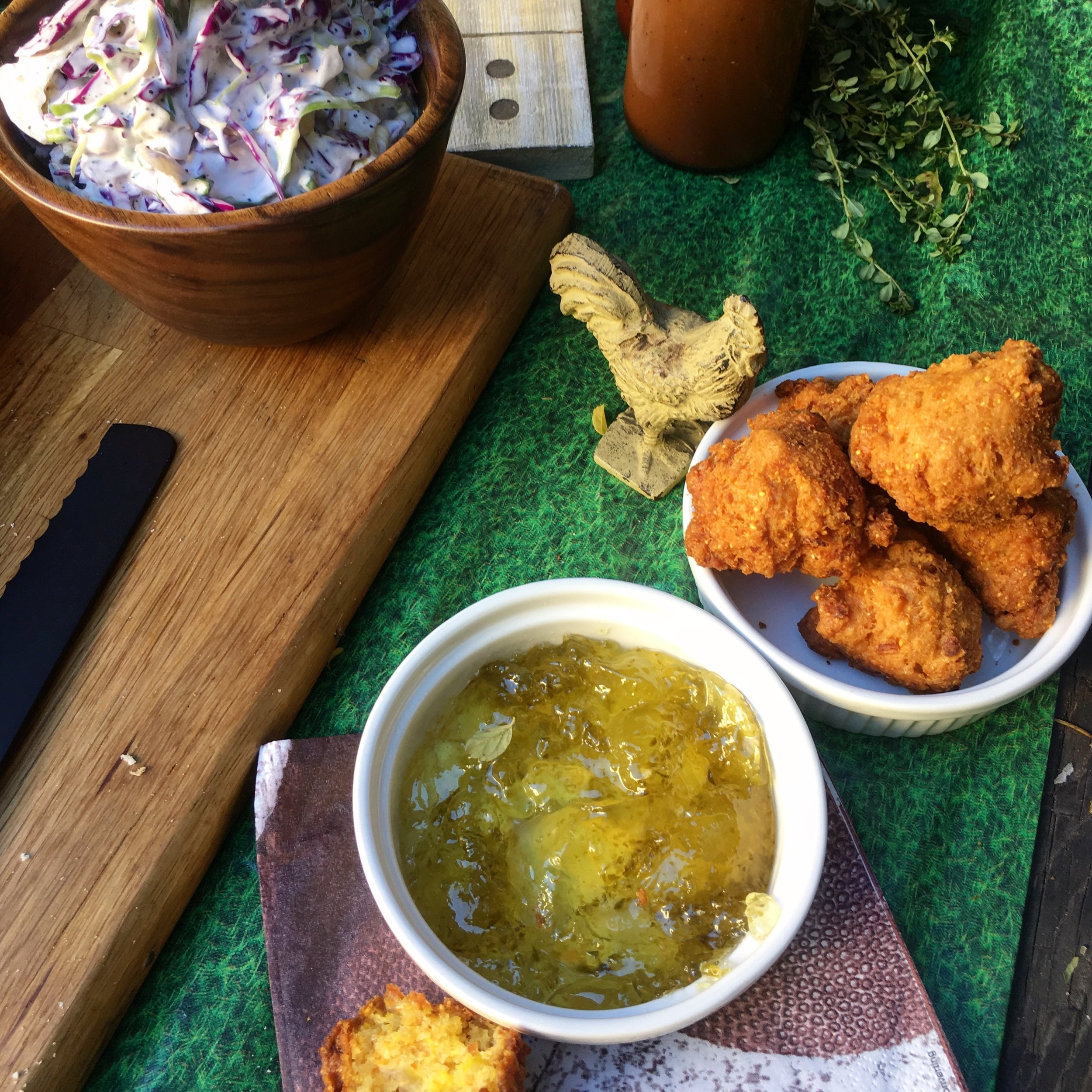 Serve the hush puppies on the side of your super hero. You can serve the Cole slaw on the side, too, or just add it as a layer to the sandwich (our pick).