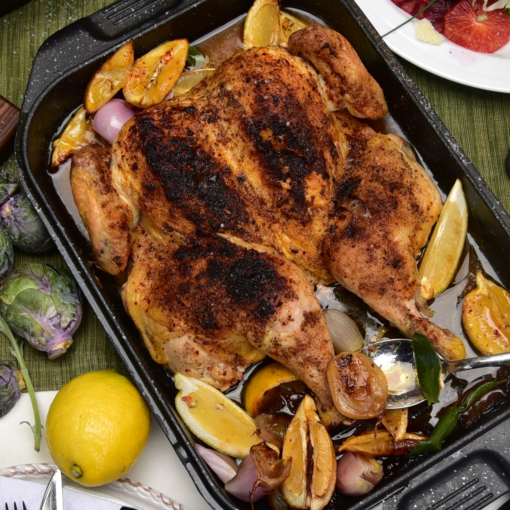 The top of the EuroCAST double roaster is a gorgeous roasting pan. Here, we see it being upstaged by an even more attractive spatchcocked chicken with its chorus of lemons and shallots that took the roasting ride alongside.