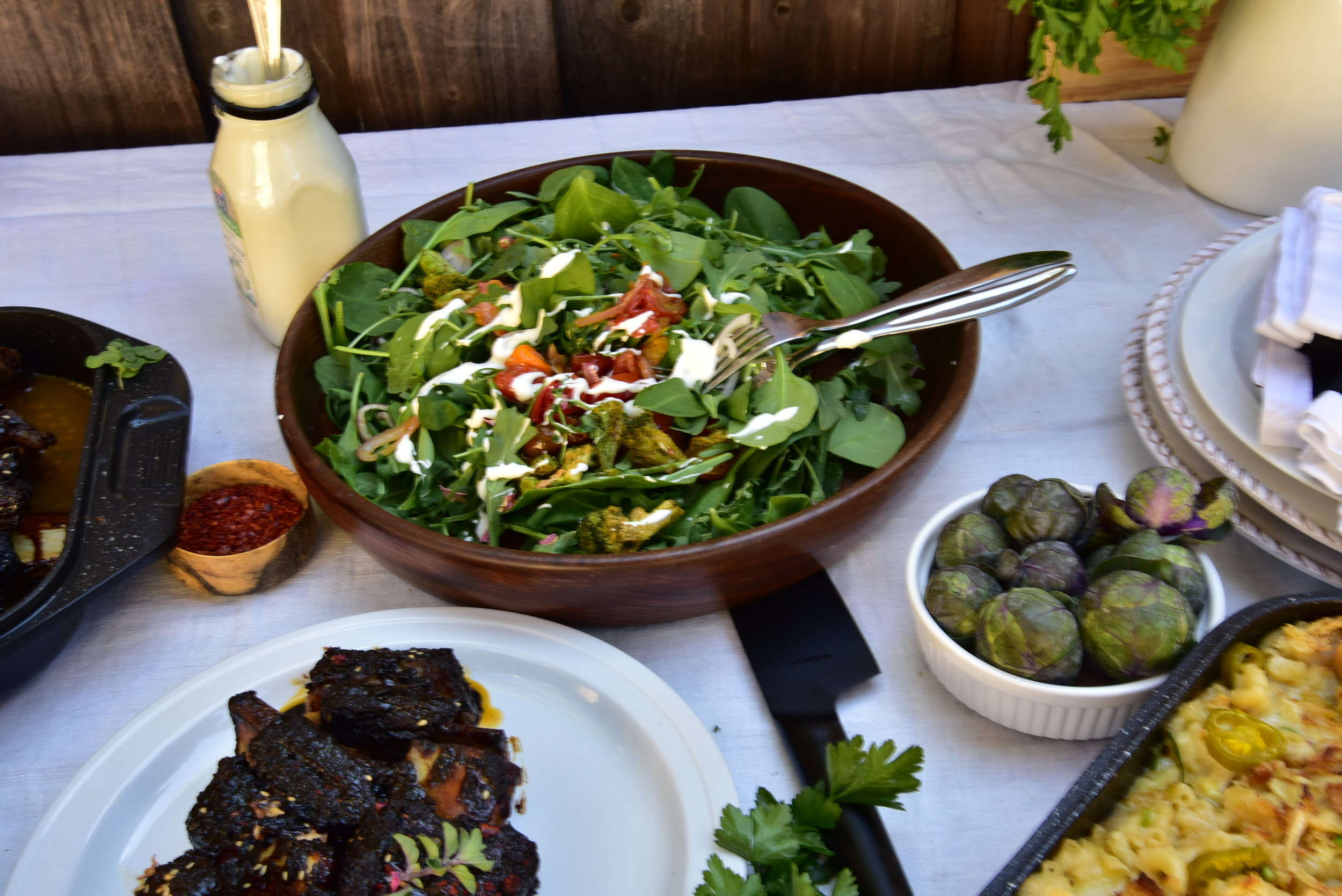 A terrific salad, or slices of radish dredged in salt, can contrast the rich rib flavor. Just as the color red looks redder next to the color blue, your ribs can taste even more stinking delicious.