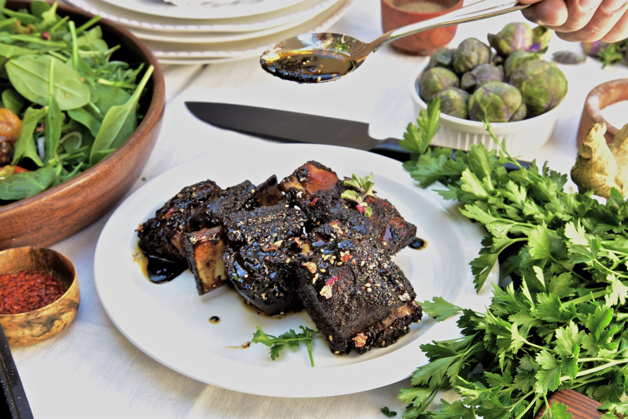 Dry rub ribs with a molasses chili paste glaze. It's even better than you might imagine.