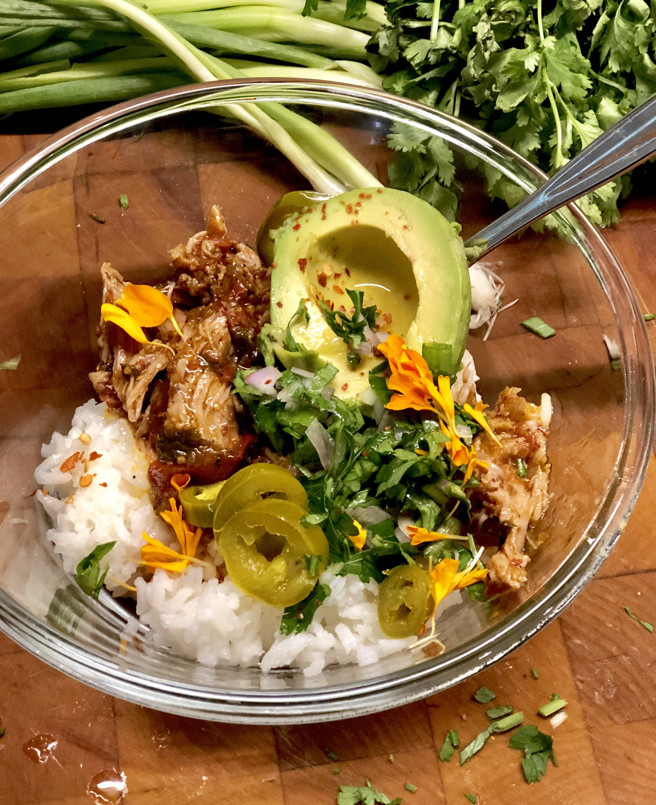 Serve it like this. People can choose the bite they're in the mood for. A bit of rice, a bit of pork. A spoonful of avocado with a bit of jalapeño. Every bite interesting.