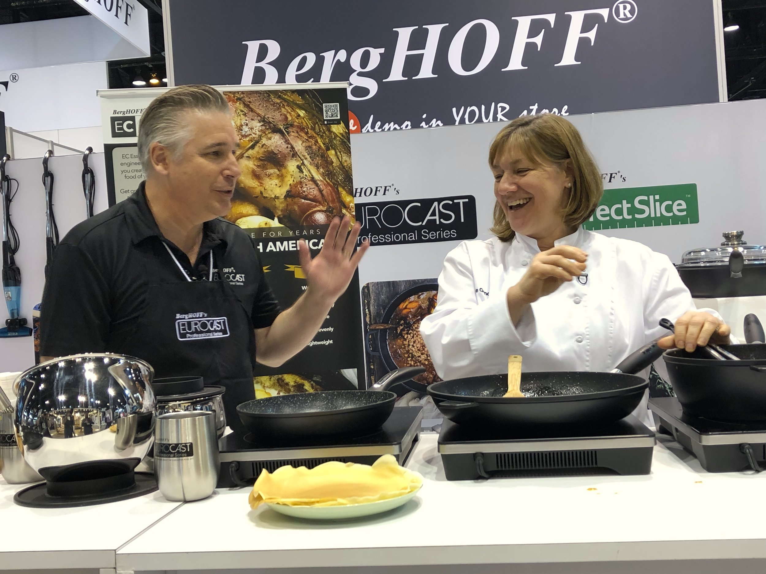 EVP of EuroCAST, Jay Laisné, demonstrating EuroCAST Cookware's Professional series and its newest ECEssentials line at IHA in Chicago, with celebrity chef Gale Gand, March 2019.