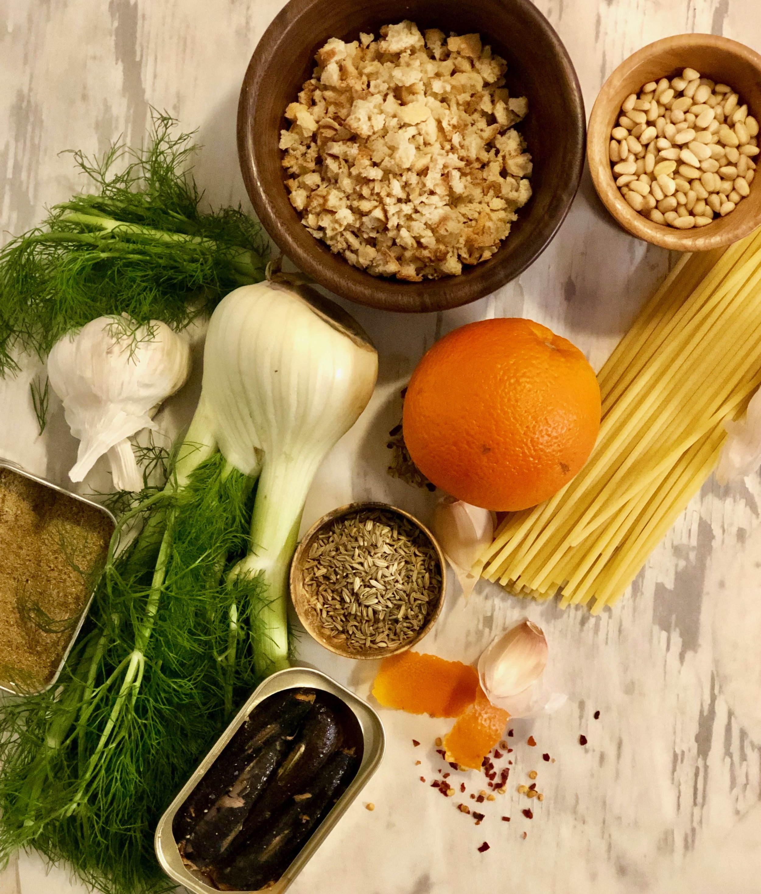 Fennel pollen, fennel fronts, fennel bulb, and fennel seeds, all on the left. Why? Because depth of flavor. The fennel pollen is buttery and aromatic. The fennel bulb is rich and like anise — a perfect marriage with sardine and anchovy. And that orange peel … I remember digging my thumbs into the flesh of a freshly picked Blood Orange in Sicily, where they're from. Sweet, lovely, juicy orange. It's the flavor of Sicily.