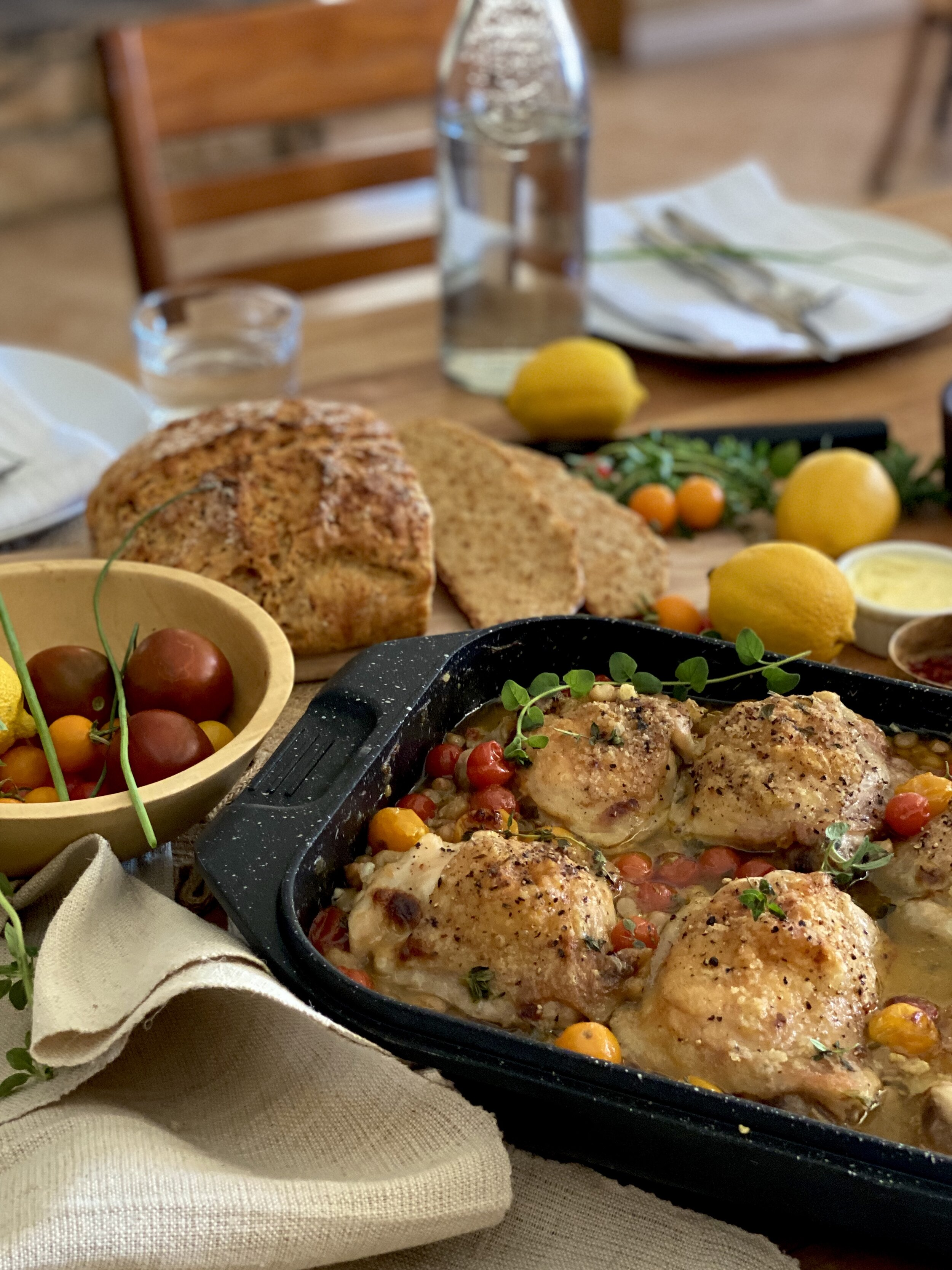 Tender bone in thighs cuddled up next to white beans, tomatoes and fragrant herbs. Serve that alongside a country crusty loaf of bread and dinner is on the table.