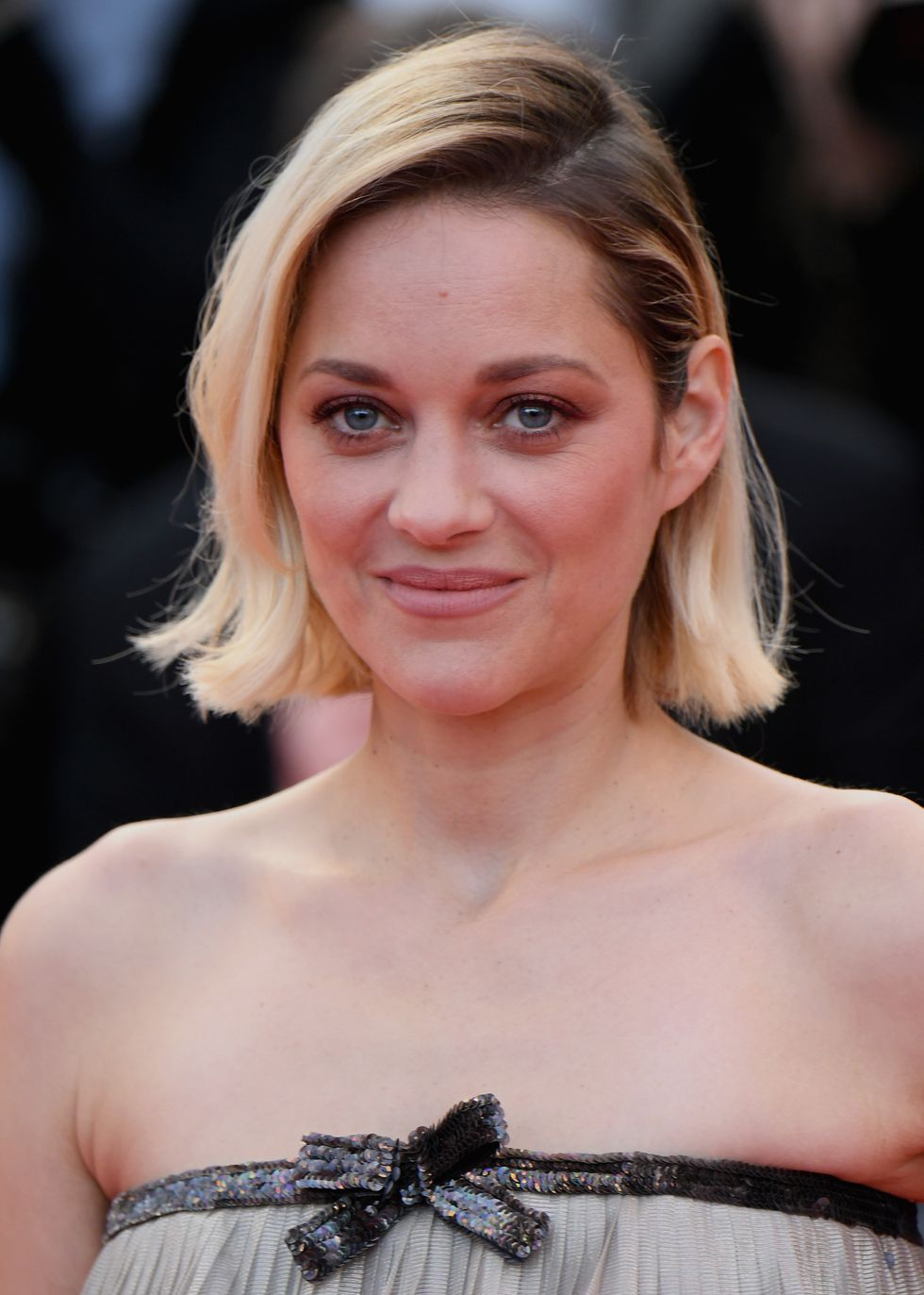 BLONDE: Softly Contrasting Hair   Marion Cotillard's surprise from brunette to blonde is sure to inspire others. What makes her switch different from other blonde makeovers? Soft brown roots and her still-dark brows. The intentional contrast is both pretty and convenient, as it will allow her hair to grow out with less maintenance.