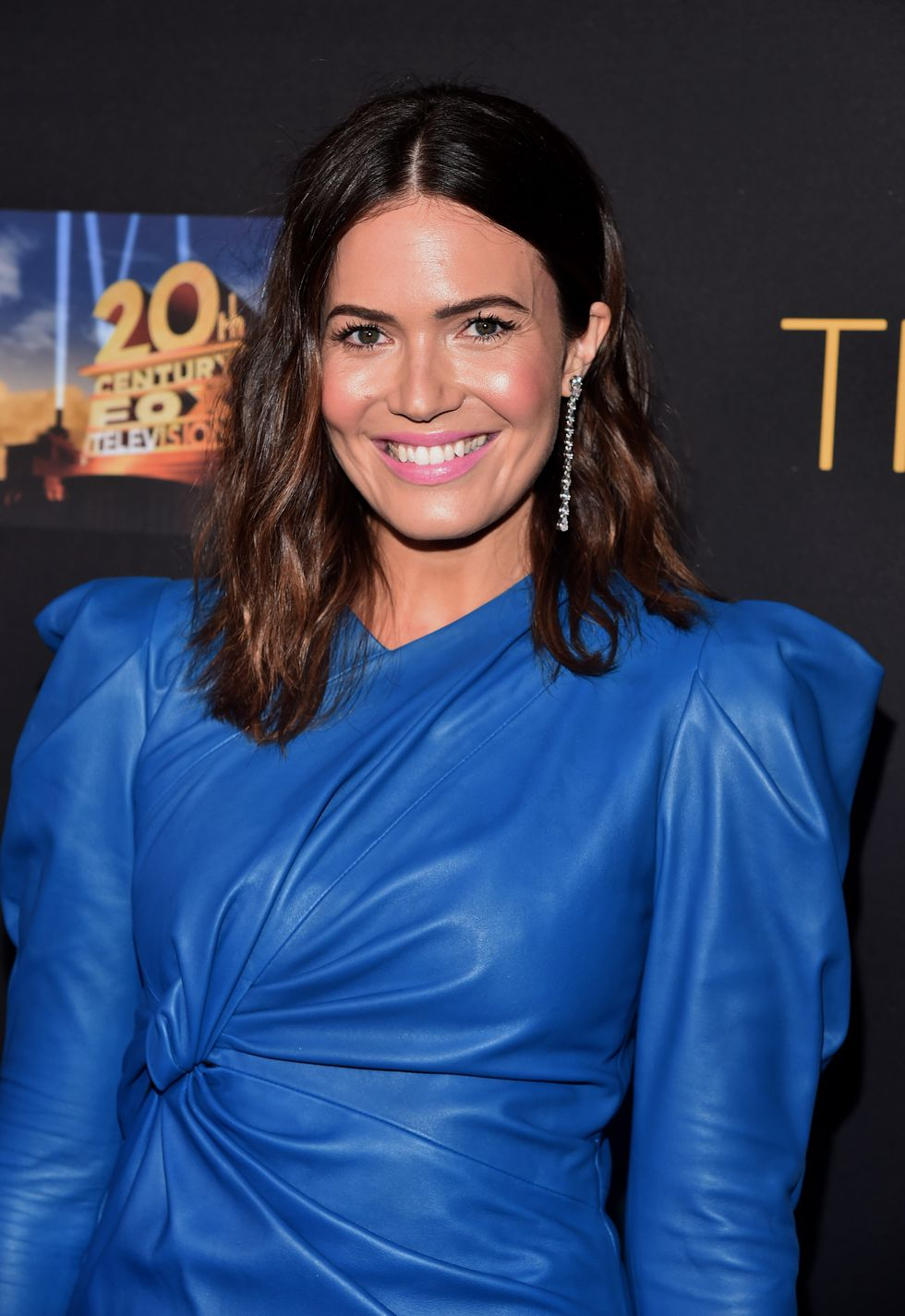 BRUNETTE: Chestnut Ombré Hair   Another two-tone look, Mandy Moore's strands at a  This Is Us  event in August fade from a rich chocolate brown to a warm chestnut. Not quite red, not quite brown, this in-between color is certainly something to bookmark.