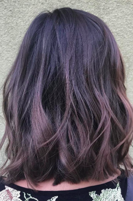 Subtle Hints of Mauve and Purple   For a more tame version of the trend, try adding dimension to your hair with ribbons of mauve and purple. Best for brunettes, this style is toned down, but fun for all ages.