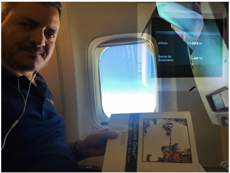 Iraqi Neurosurgeon Dr. Ammar Hadi reading John's book on his way to a conference in London.