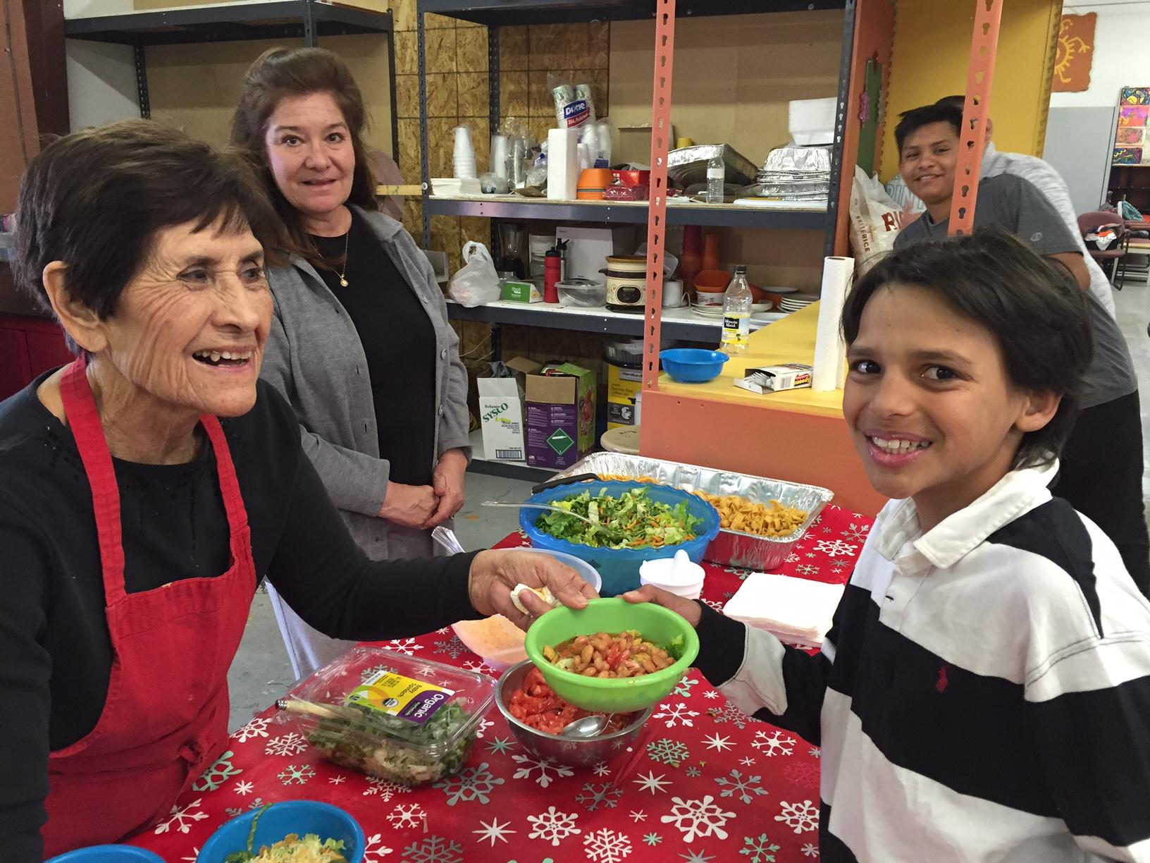 2016 After-School Meals Program - senior volunteers serving students