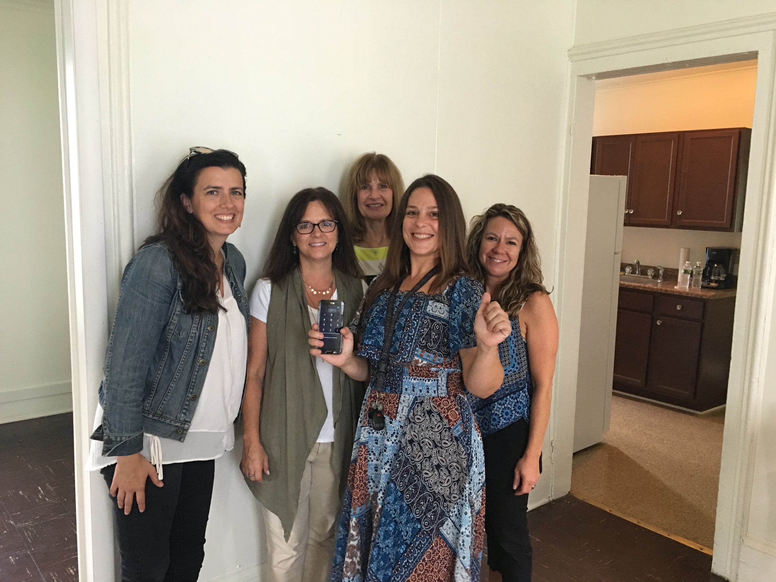 One of our Exodus moms seeing her new apartment for the first time.