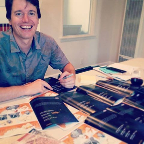 Joel and I signing all the copies!