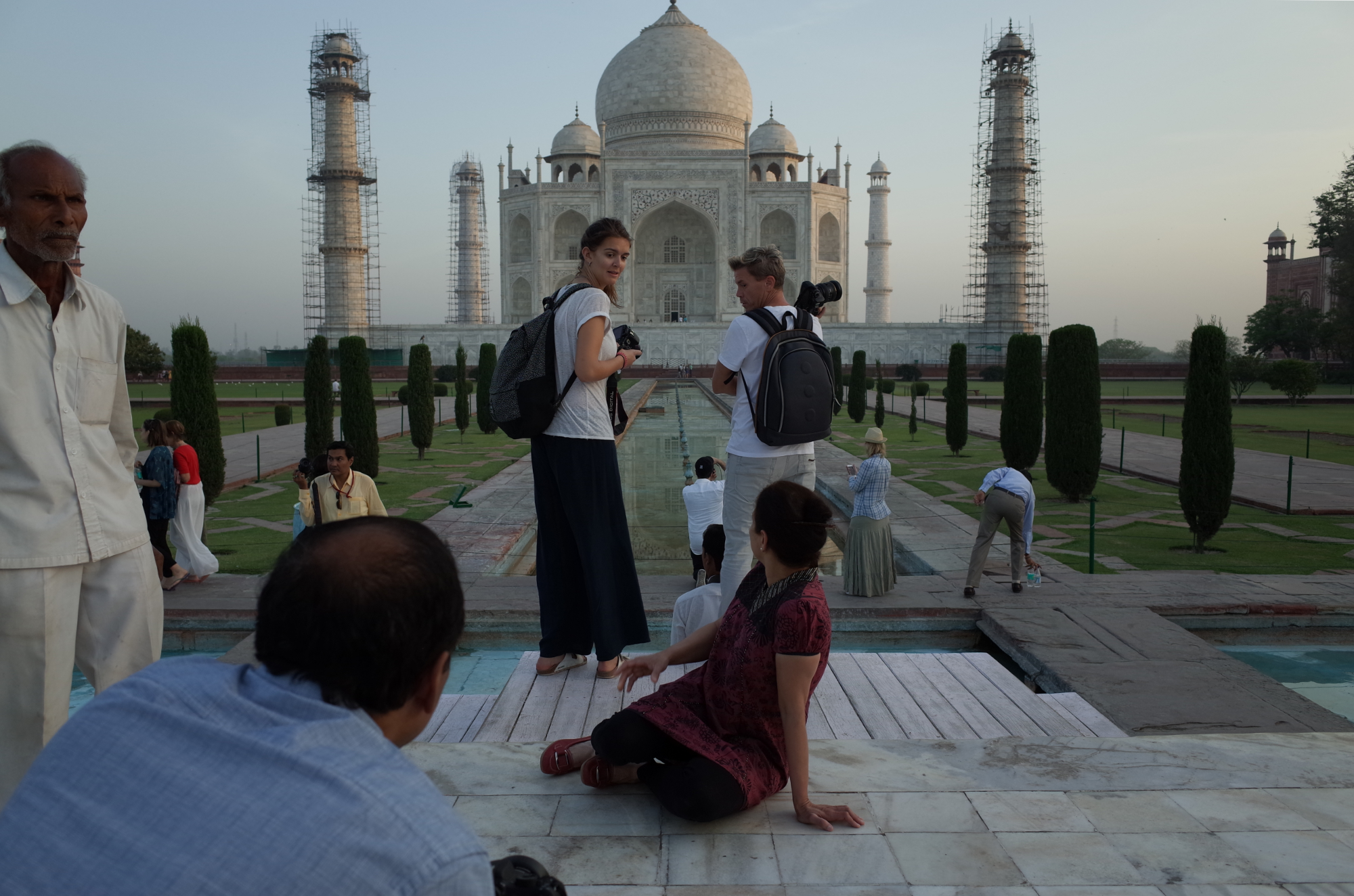 Exchanging frustrated glances, tourists hustle for the best spot to photograph the Taj Mahal at sunrise. Photo By: Sarah Tesla