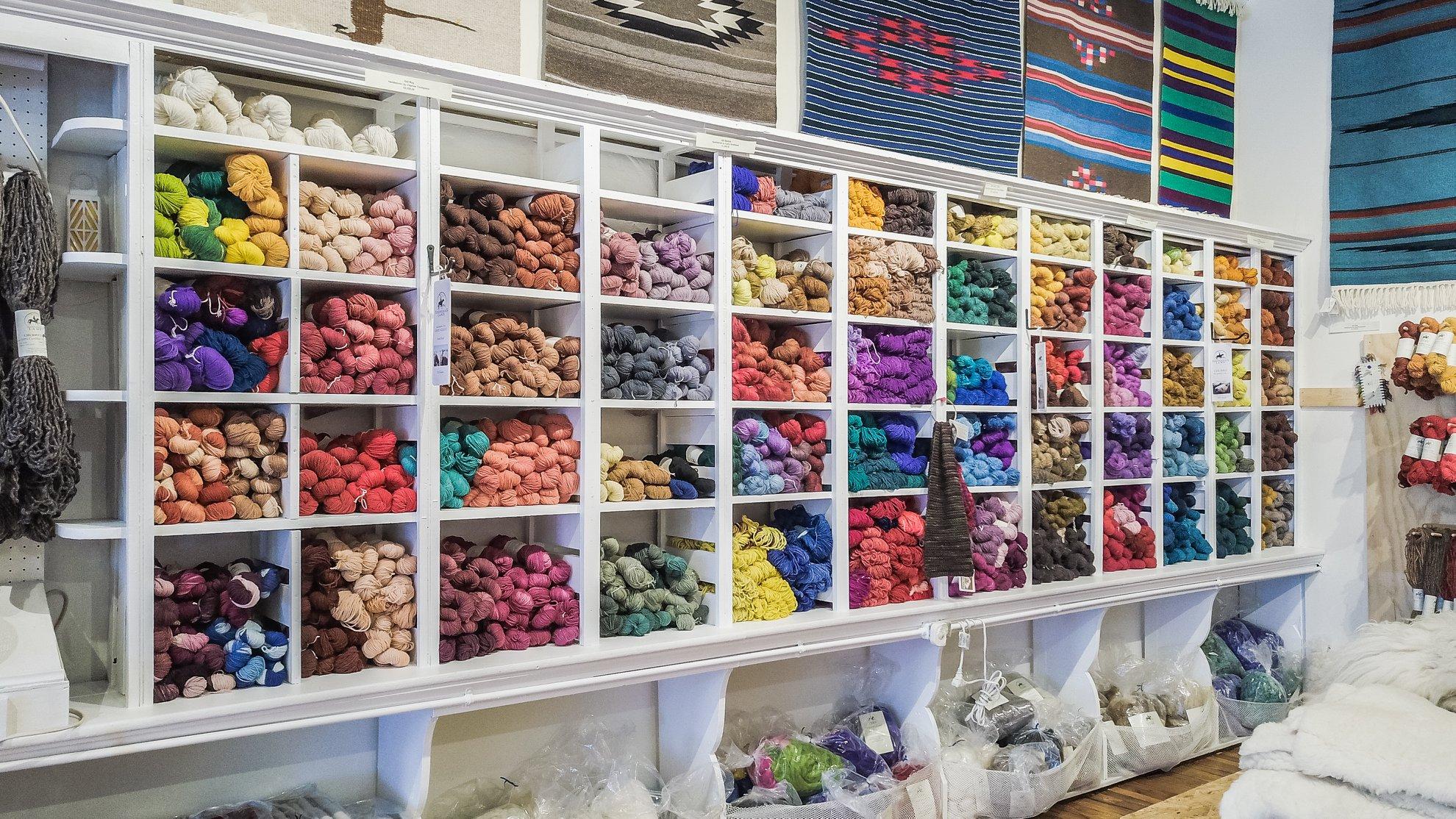 Yarns and weavings for sale at Tierra Wools. Photo by Dan Monaghan