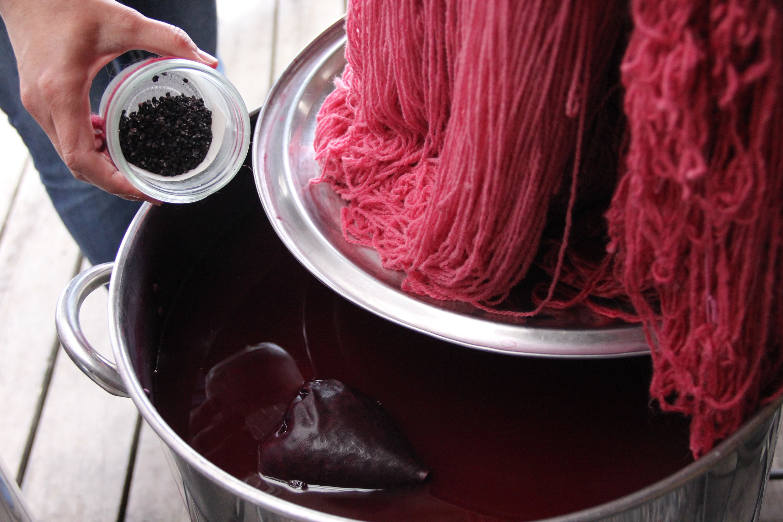 Freshly dyed yarn, straight out of a cochineal bath in our Natural Dyeing area