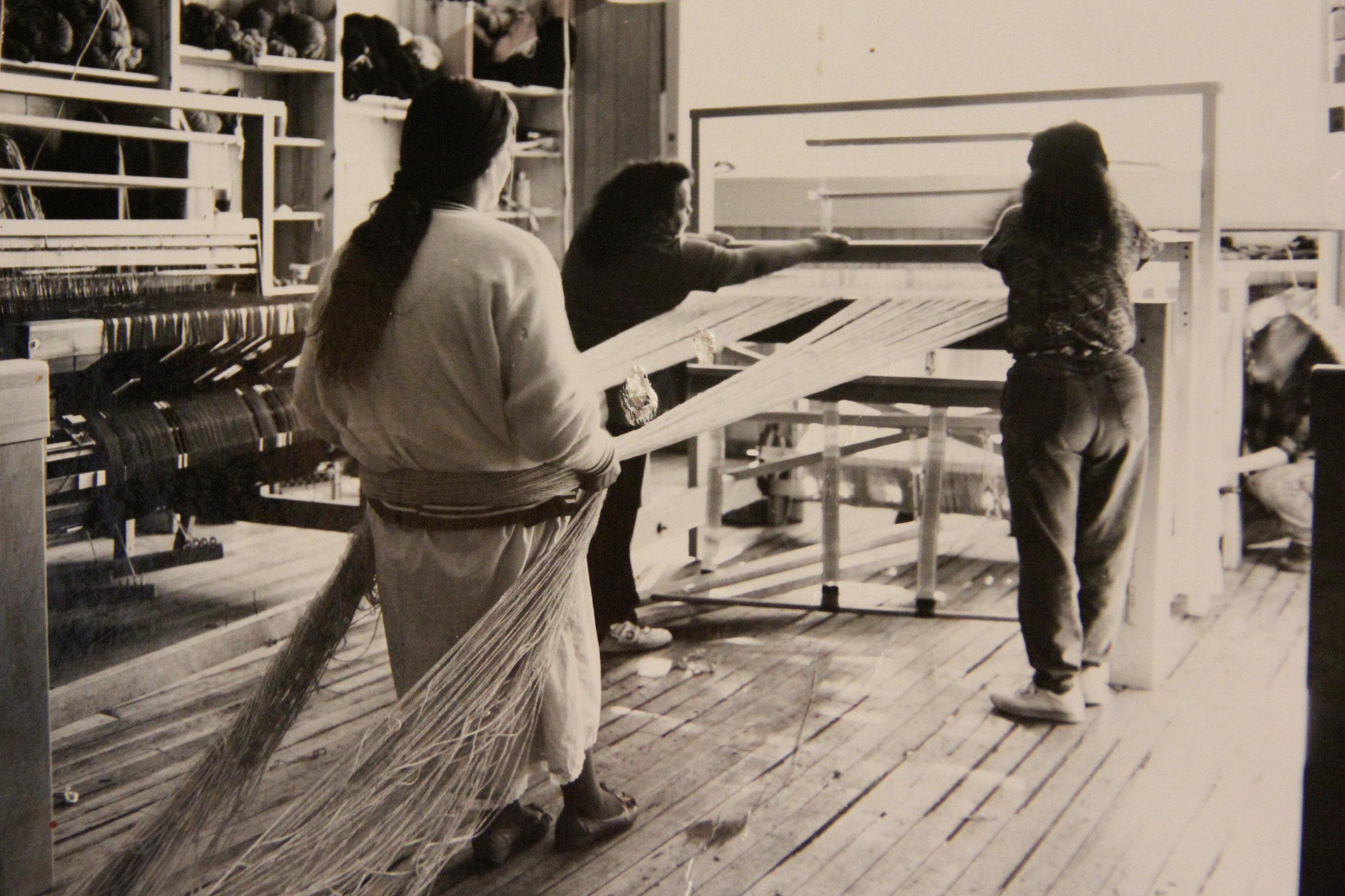 Tierra Wools weavers warp a loom in the 1980s