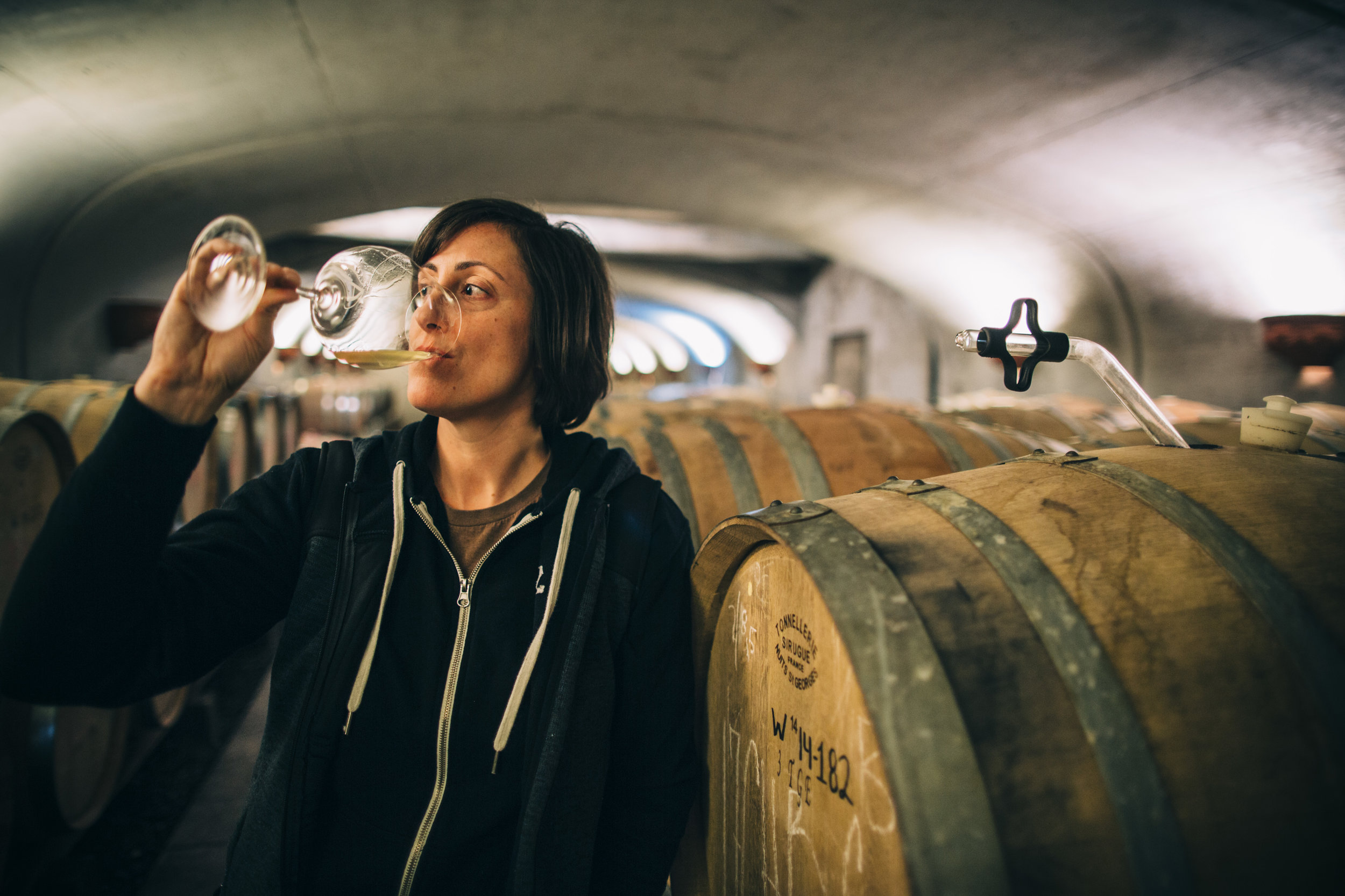 Gina Hennen, Winemaker at Adelsheim, Tastes Wines in Barrel Room