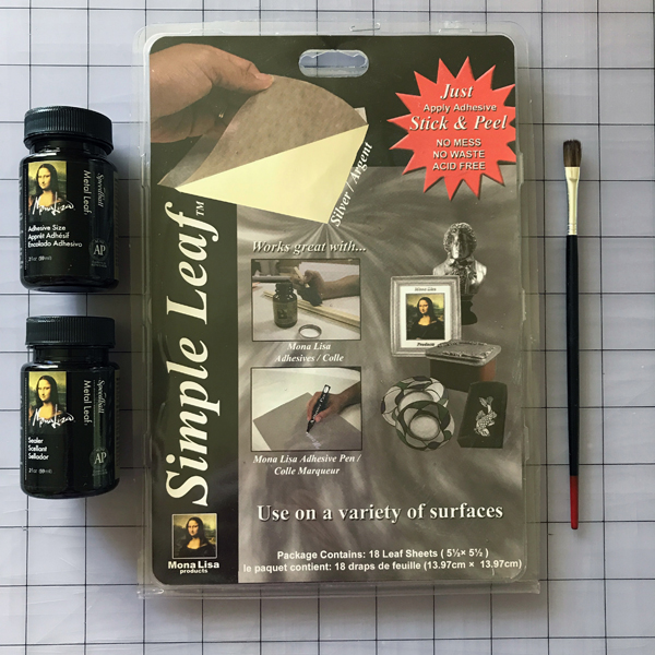 Here's a shot of the leafing supplies I used. If you can find this Simple Leaf stuff instead of the traditional sheets, I highly recommend it. These sheets are the leaf adhered to a backing sheet, so you don't get little bits flying around and breaking with a whisper like you do with the traditional sheets. It's the same leaf, but so much easier to work with! While the sealer and the adhesive are said to clean up with soap and water, use a brush with these materials that you aren't attached to.