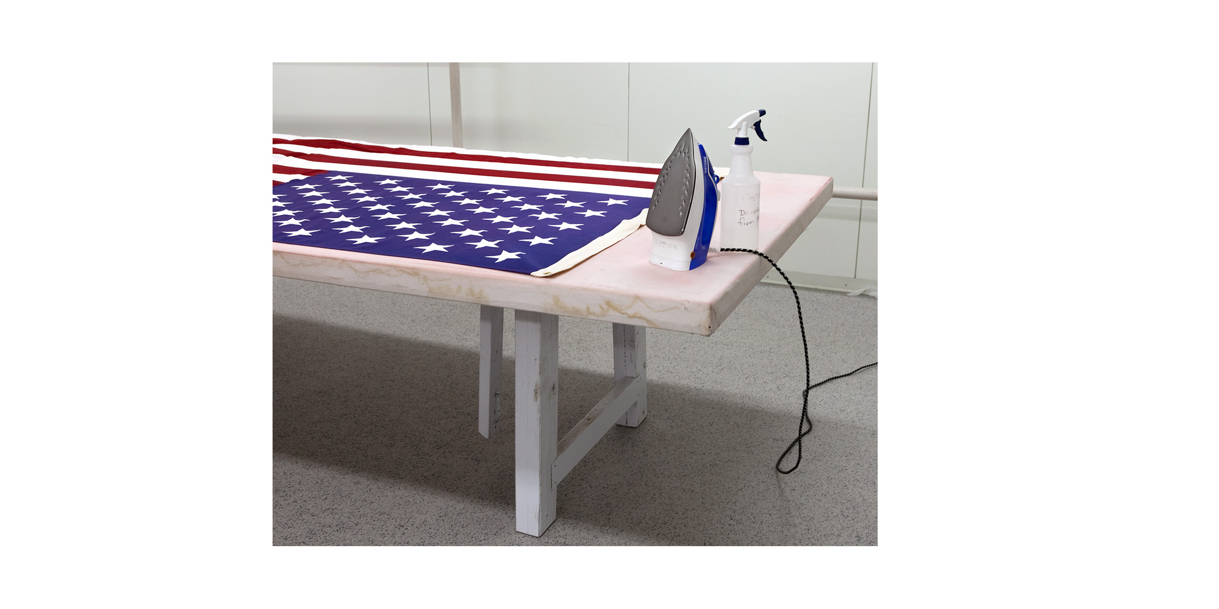 The American flag is always clean and ironed before being placed on a transfer case.