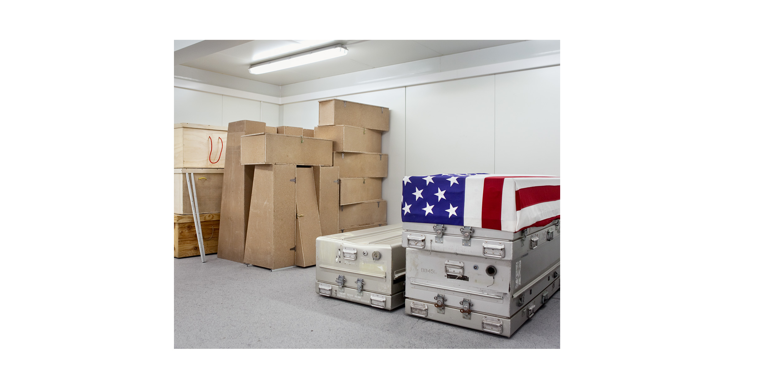 Stacked in a small room at the Mortuary Affairs Collection point in Kandahar Airfield are the transfer cases for civilian adults (left),  children (centre) and US soldiers (right). During a 24-hour span, a mortuary affairs team can process up to 12 remains in the facility.