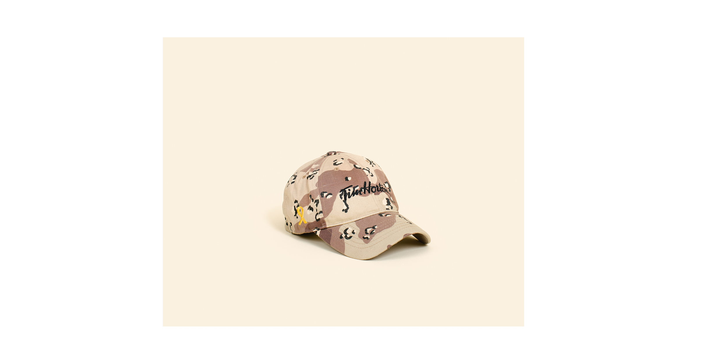 Tim Hortons camouflage cap - a highly coveted souvenir by soldiers and contractors serving at Kandahar Airfield.  Since opening in Kandahar Airfield in 2006, the popular Canadian coffee shop Tim Hortons has served four million cups of coffee, three million donuts and half a million iced cappuccinos and bagels to 2.5 million customers. After five years of serving customers from 37 different nationalities, the Tim Hortons outlet in Afghanistan closed in 2011.