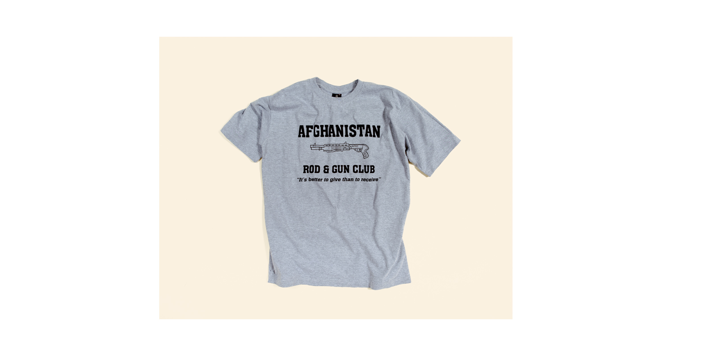 """""""Afghanistan Rod & Gun Club - It's better to give than to receive"""" T-shirt sold in a gift shop at """"The Boardwalk"""", the social center of Kandahar Airfield, which offers Western style cafes, gift shops, restaurants and sports fields. The shirt has become popular with soldiers on the front line and their supporters back home."""