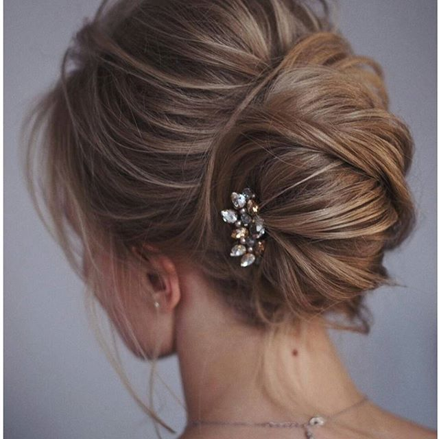 Adding a little something will give a new look to your bridal hair style. I love this subtle hot of bling for a traditional French twist #bridalhair #weddinghair #bridalhairaccessory #abridalpiece  Find similiar pieces at www.abridalpiece.com... All pieces 50% off