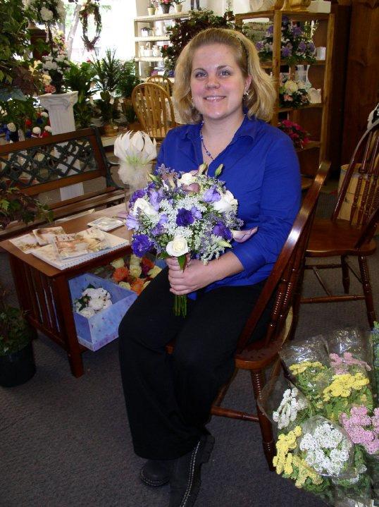 Anna with wedding bouquets.jpg