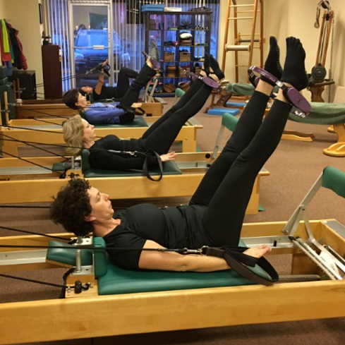 Our semi private reformer classes are a great way to enhance your Pilates workout! Tone, improve posture, balance, flexibility and strengthen your way to a Pilates body with the Pilates reformer. Our Pilates reformer studio classes are semi-private and limited to 5 students for a more personalized experience.