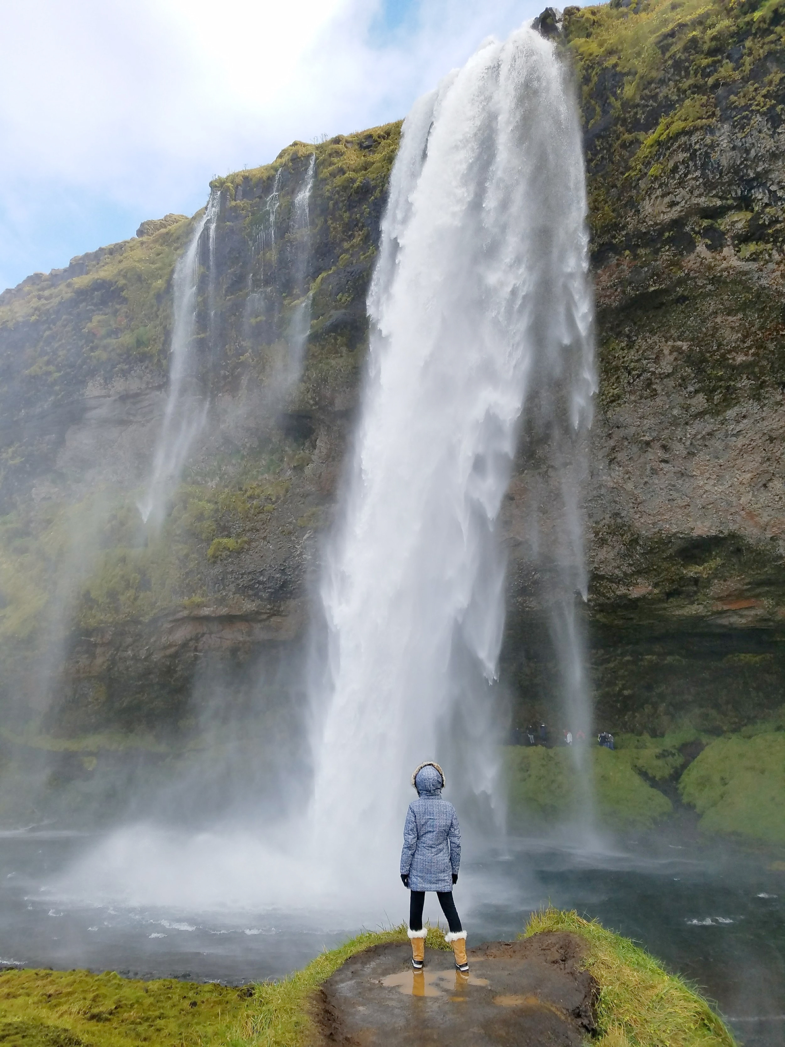 Seljalandsfoss waterfall is one of the prettiest waterfalls in Iceland. In the right conditions, you can walk behind the falls. #iceland #travel #waterfall #icelandtravel #traveltips #europetravel #bestwaterfalls andsfoss but hidden by cliffs. #travel #iceland #icelandtravel #wanderlust #europe #waterfalls #naturepics #icelandwaterfalls #seljalandsfoss #seljalandsfossiceland #waterfallsaroundtheworld #traveldestinations