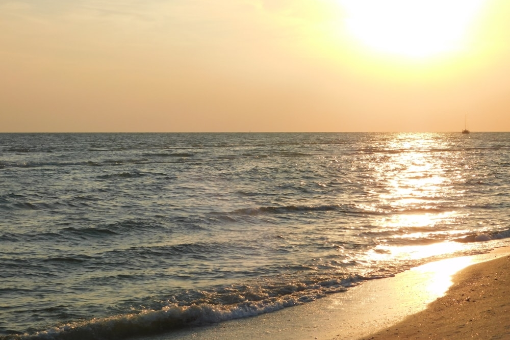 Sanibel Island on the Gulf Coast of Florida has amazing sunsets from the beach and is much quieter in summer than in winter.