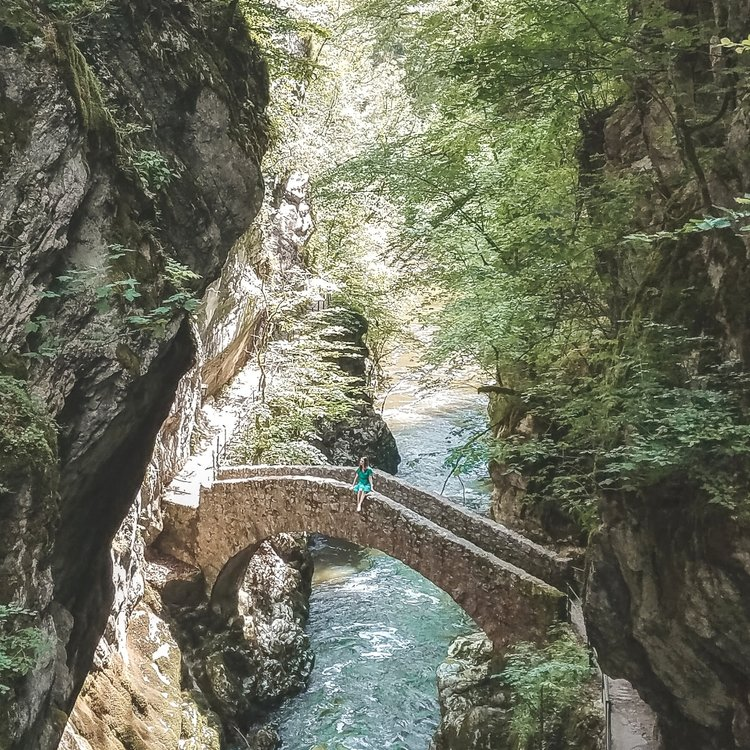 The rocky and green Areuse Gorge in Switzerland has a stone bridge that makes for a perfect picture.
