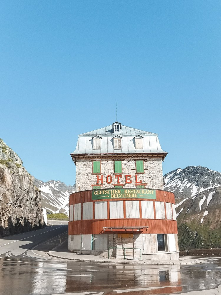 The abandoned Hotel Belvedere is on the Furka Pass in the Swiss Alps right next to a glacier.
