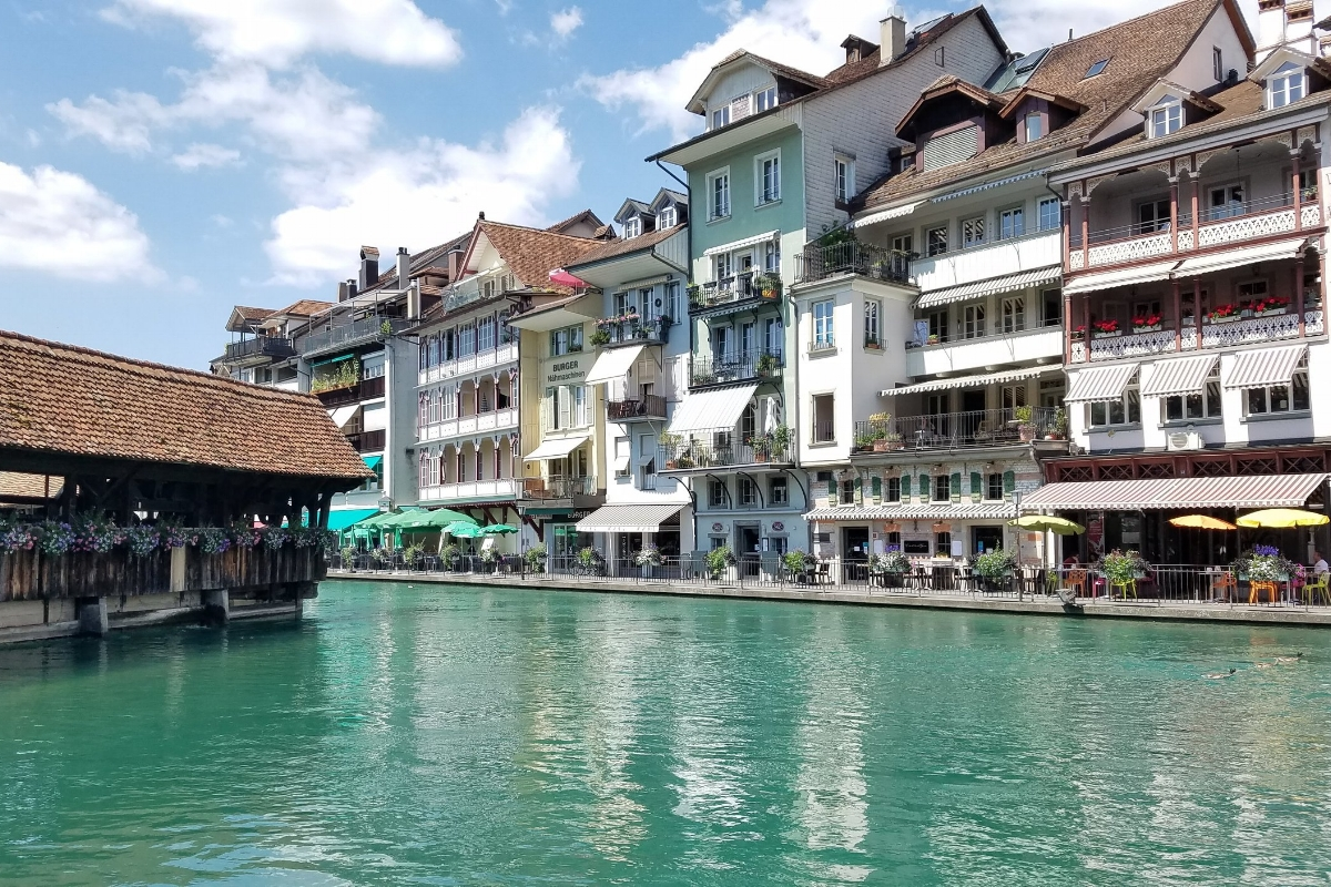 Emerald waters flow alongside colorful buildings in lakeside Thun, where you'll find tons of shopping and a pretty, white castle. This Switzerland road trip itinerary will help you plan your vacation to see Thun and other picturesque villages, castles, mountains, lakes and more!