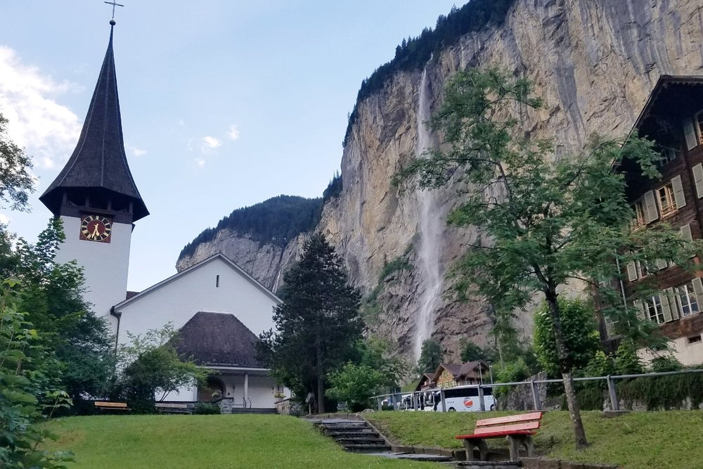 Lauterbrunnen in Switzerland is surrounded by dozens of waterfalls. It's one of the cutest villages to visit on your Switzerland road trip.