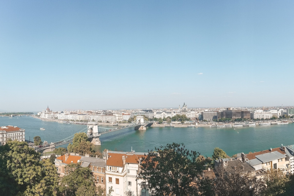 The view over the Danube River looking toward the Pest side of Budapest, one of the grand capital cities covered in this one-week itinerary to Prague, Vienna and Budapest.