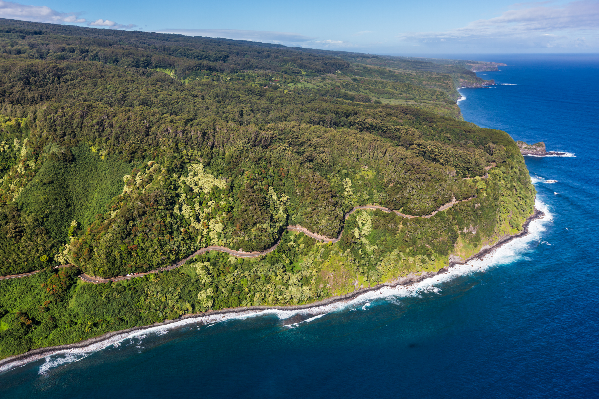 The Hana Highway weaves along the east coast of Maui, as seen in this aerial shot of the island.