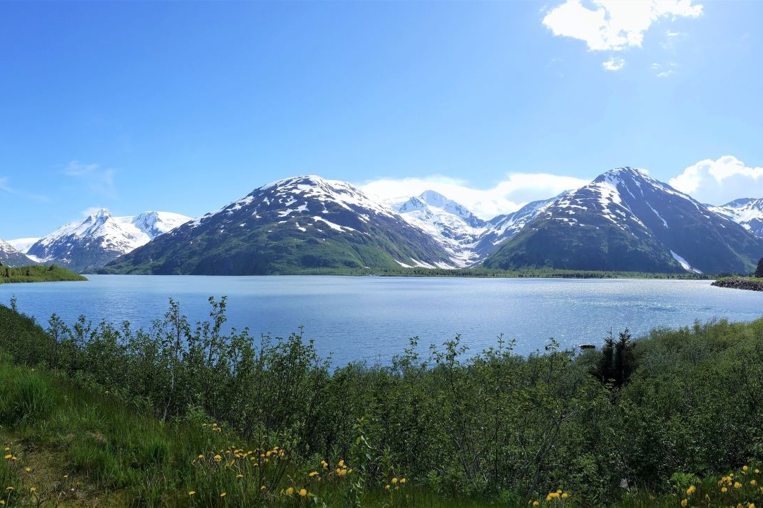 Day trips from Anchorage include the Kenai Peninsula, where you'll find this blue glacier-fed lake surrounded by greenery and mountains.