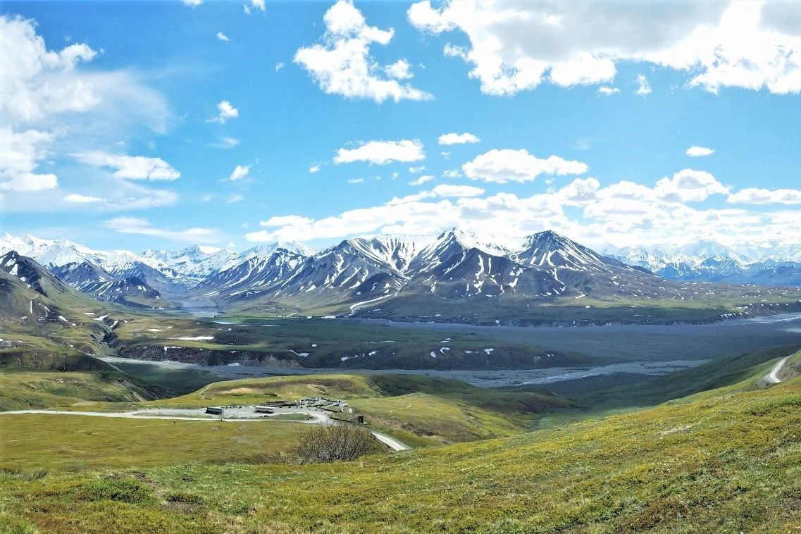 An aerial view of the Eielson visitor center surrounded by mountains in Denali National Park and Preserve from the Thorofare Ridge Trail.