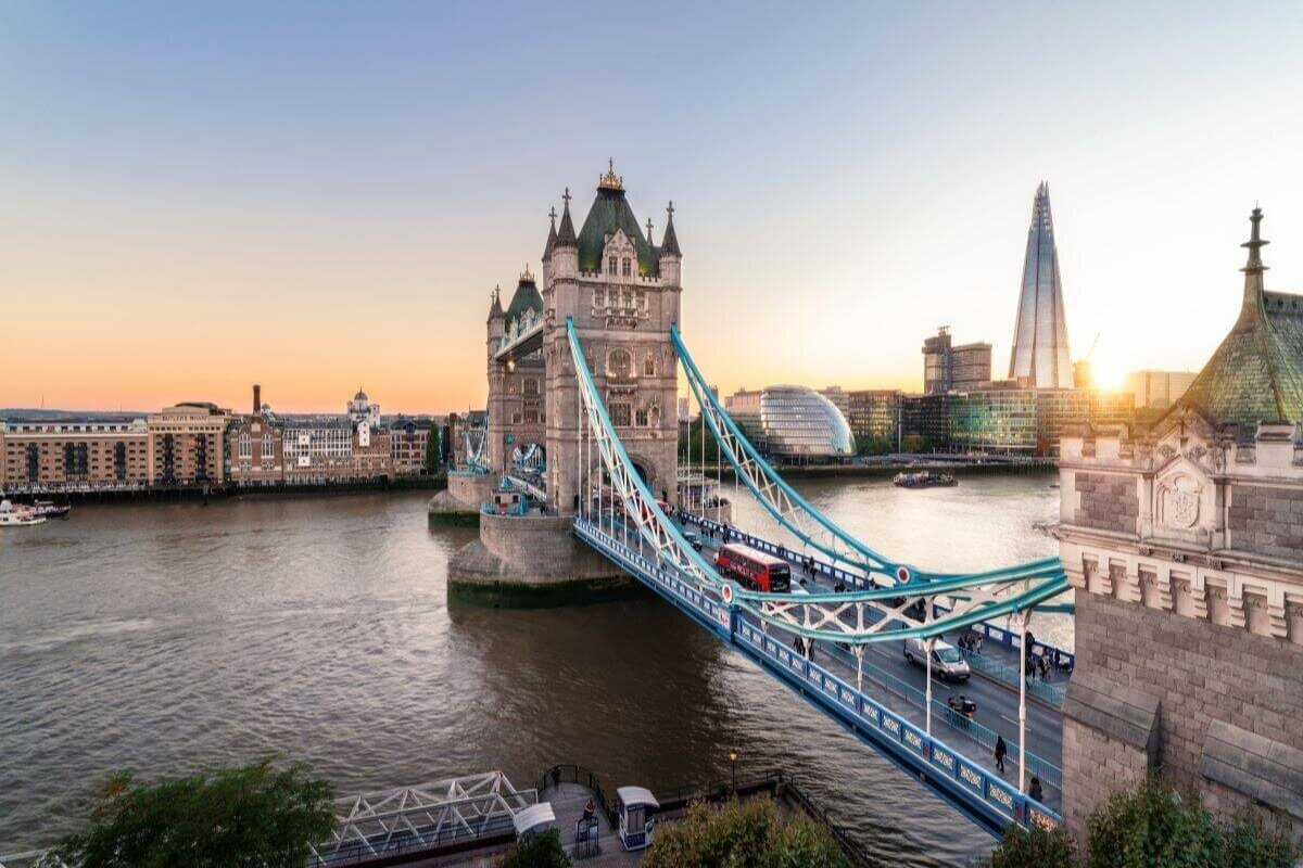London landmarks include the Tower Bridge, pictured with the point Shard skyscraper to the right and the river flowing below.