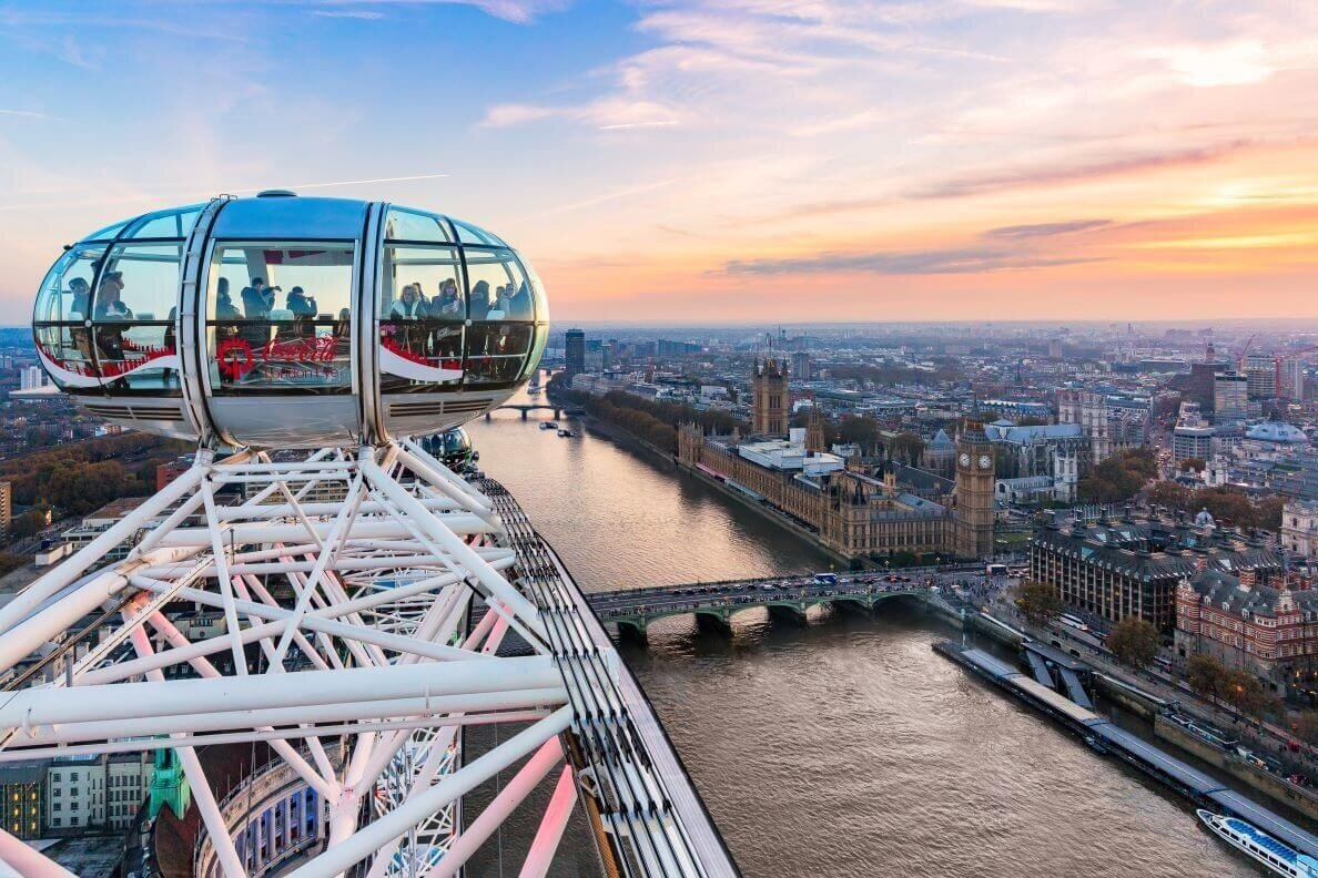 The city of Westminster with Big Ben tower on the right and a glass pod of the London Eye on the left sitting atop the observation wheel, one of the best views in London.