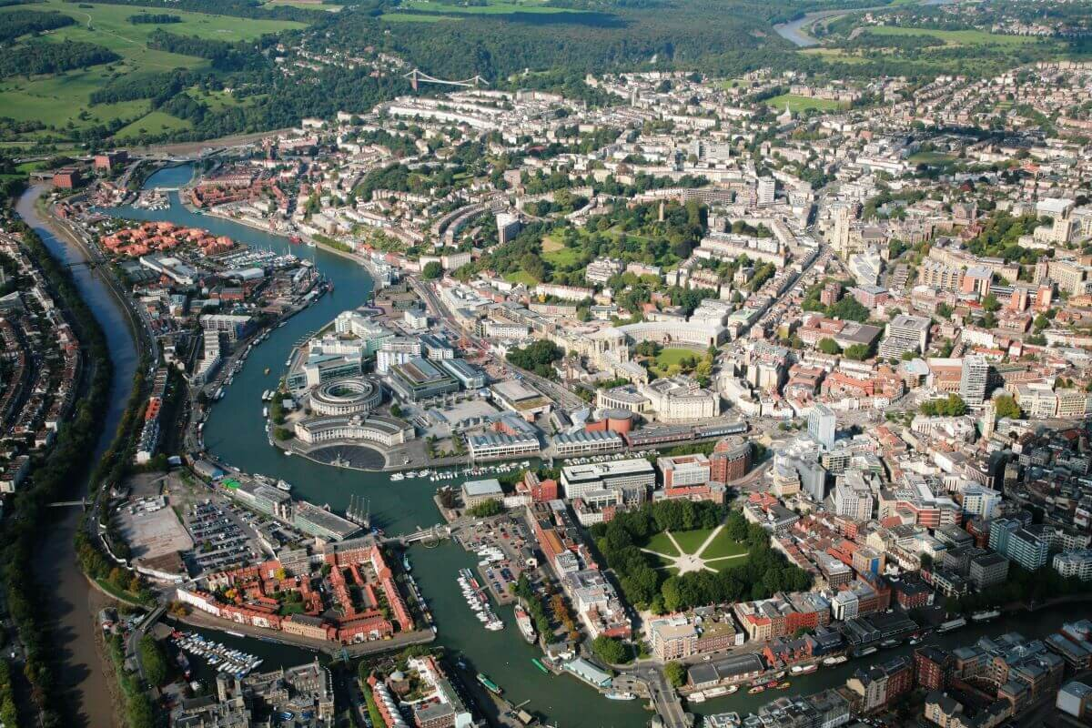 An aerial shot of a river winding through the city of Bristol, a day tour from London about two hours away.