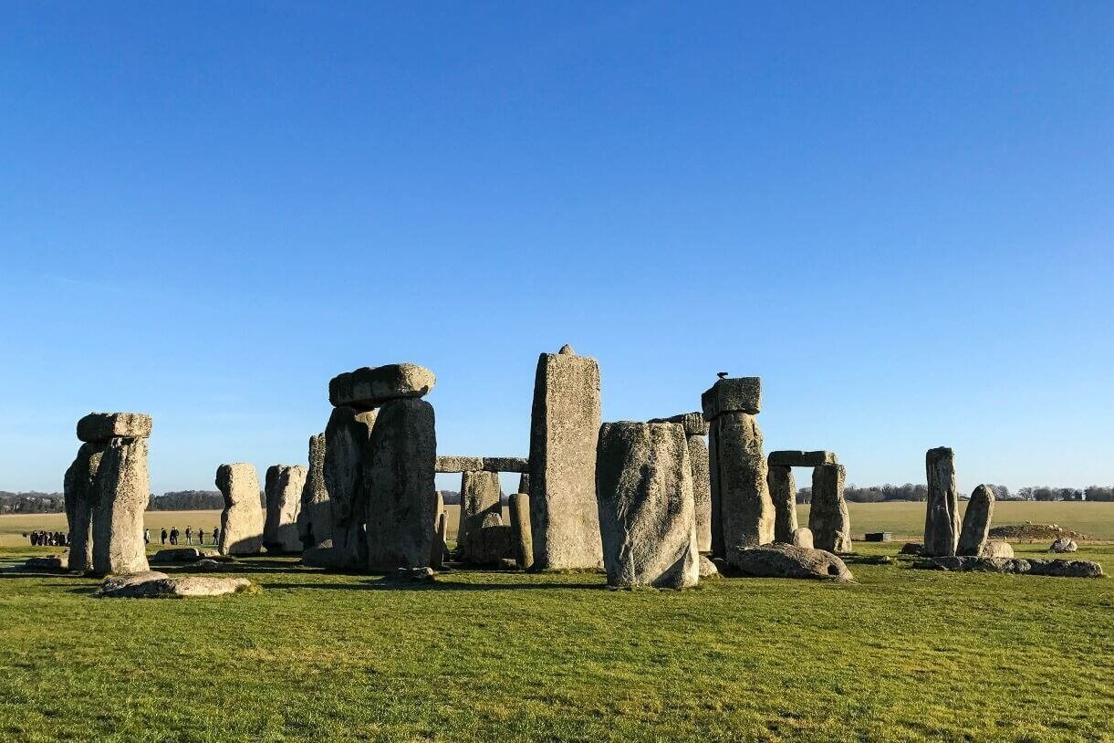 The ancient stone circle under a blue sky at Stonehenge, a London day tour.